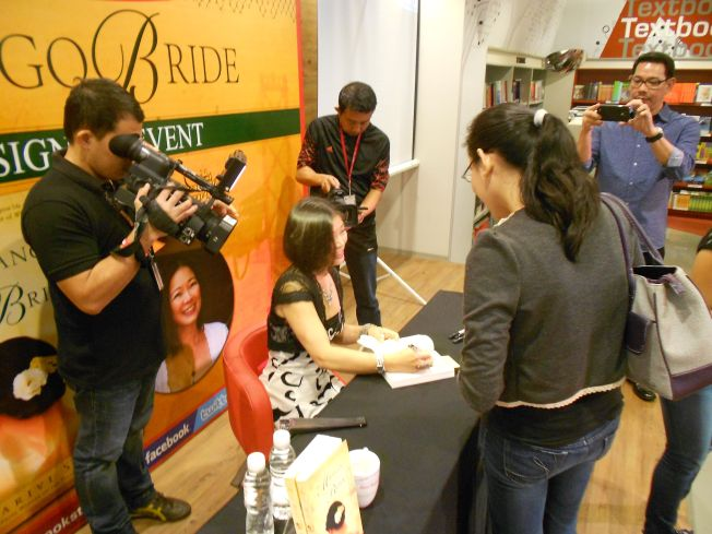 Autographing books after the Q&A