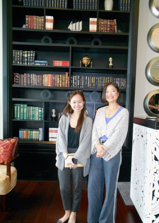 Manica and me by the Writers Bar's wall of books