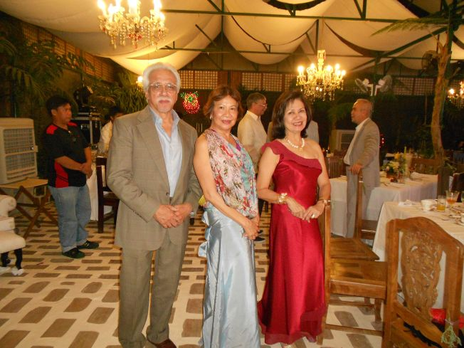 Sonya in blue skirt with her guests Renato and Dolly
