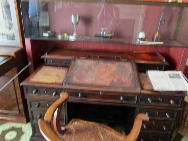 The desk on which he wrote one of his novels - note the worn leather top.