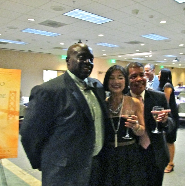 College friend Michael Gil Magnaye toasting to the evening's success with Ambassador Thomas