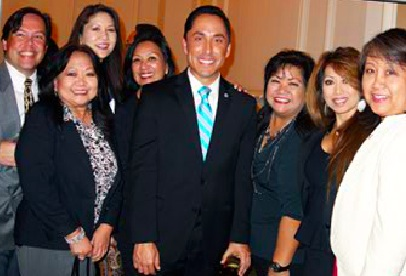 Silayan Filiipina Executive Director Joy Ella de Guzman to the right of San Diego Councilmember Todd Gloria with the Silayan Filipina members