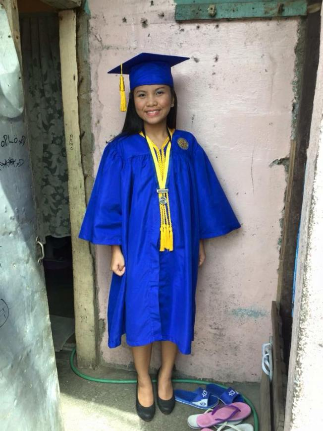 Glecy at her doorstep on graduation day. Photo credit: Charu Galvez Asperin