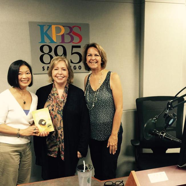 Midday Edition's Host Maureen Cavanaugh flanked by me and Susan McBeth of Adventures by the Book, after our interview